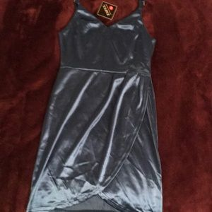 Selling a Teal, shiny dress for a night out.